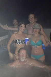 Friends in the hot tub on the deck