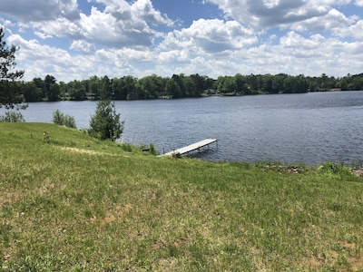 View from patio. Small swimming area to the right of dock.