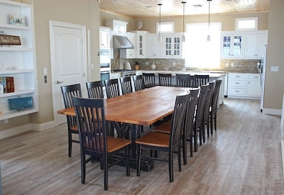 Dining area and kitchen fully equipped with high end appliances and cookware.