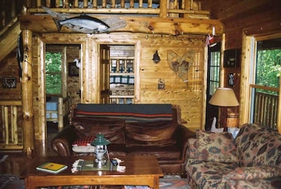 Knotty pine & Cedar everywhere , ceiling, walls and floors. No wood in hot tub!