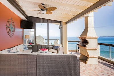 Indoor-outdoor living space features big ocean views, cable TV, and BBQ chimnea.