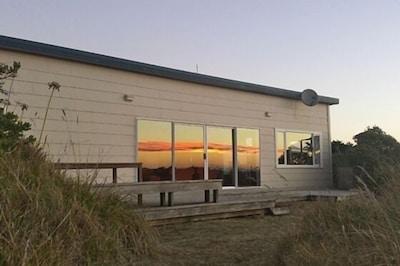 Sun setting on the beach house