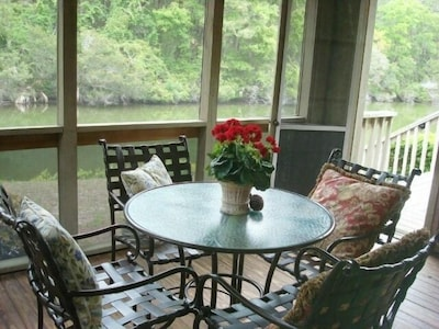 Screened porch  to enjoy dining while watching birds feast& nature