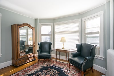 Room 1 has large bay windows, allowing natural light to fill the room