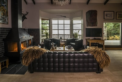 living room with lakeview and fireplace