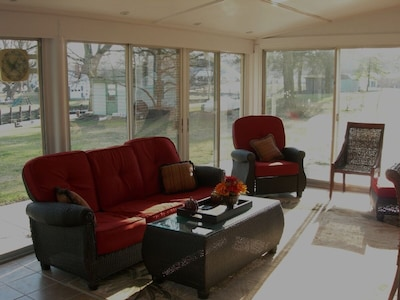 Sun Porch with sliding screens and glass sliders, hot tub on deck