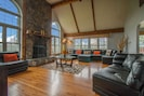 Huge, real stone fireplace, soaring ceilings, plenty of seating for everyone!