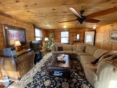 Cabin living room is spacious and luxuriously appointed for comfort