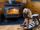 Cozy wood stove for supplemental heat or simply a romantic glow to cuddle up by