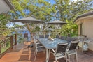 Outdoor deck, large table and chairs and bbq
