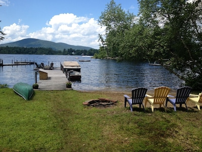 Lake front with dock, private sandy beach, fire pit, canoe and row boat