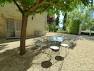 Cottage courtyard with front door and outdoor dining area