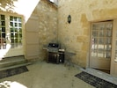 Gas barbecue near outdoor dining table