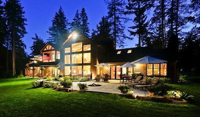 The 24 foot wall of windows & spacious back patio afford stunning water views.