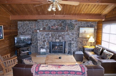 Living Room with gas fireplace, HDTV and DVD player