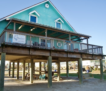 Large deck looking towards the beach. Picnic tale, large BBQ grill, swing seat