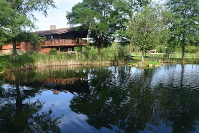 Lodge from across the waterfall pond