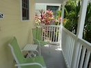 Have a morning cup of coffee or a cold beverage on the front porch.