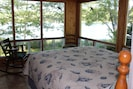 Master bedroom; awesome views of ocean with large glass windows on three sides