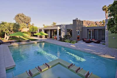 wonderful salt water pool, hot tub and private yard area with multiple seating