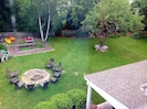 View of the backyard showing fire pit and kayaks