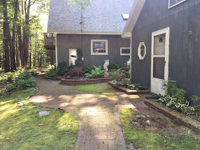Stone path with side garden.