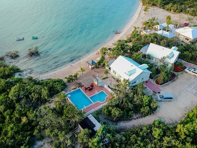 Two cottages situated directly on the beach. This cottage #2 is next to the pool