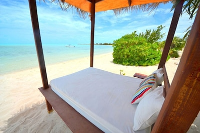 Spend the day on the day-bed and drift away by the cool tropical breeze