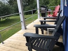 Covered back deck with beautiful water view and Napoleon grill