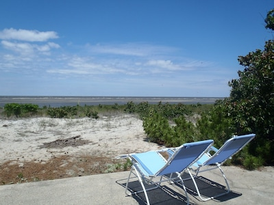 Enjoy unobstructed water views from beach front patio
