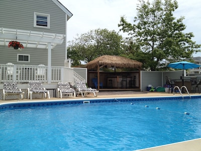 Enjoy our huge pool...Everyone loves the  Tiki Bar!