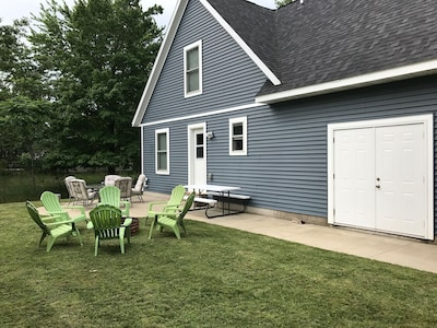 Back of cottage -  complete with fire pit, Adirondack chairs, picnic table and p