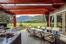 Plenty of seating, hot-tub, barbecue views.  Perfect setting!