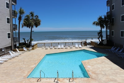 View of pool & ocean from our deck. Sandy beach is just down the steps