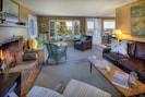 Inside, the big living room offers areas for  lounging, reading,  talks, or TV.