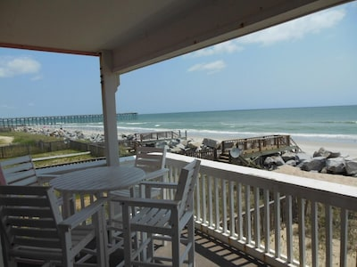Covered Deck Vacationing right on the beach, can't get any closer or better!