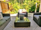 Take the slider by the kitchen to back patio lounge area.