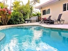 Private Heated free form pool, coral pavers, hot tub, Lush tropical surroundings