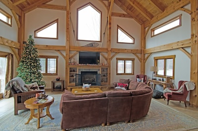 Vaulted ceiling in great room, gas fireplace and flat screen TV with DirectTV