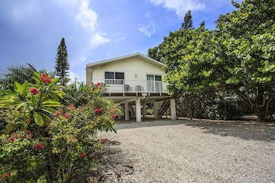 Plenty of parking and all you need  for the white sand beach just steps away.