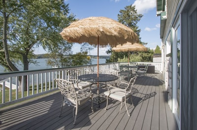 Enjoy the lake views from the wrap around deck.