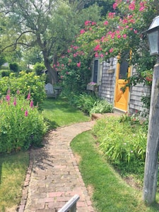 """walkway to """"Barque"""" with view of perennial gardens"""