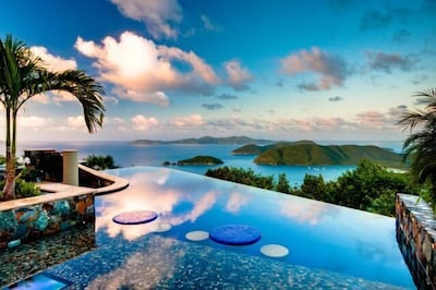Infinity Pool with Sun Shelf, Cocktail Tables & views to Cinnamon Bay Beaches