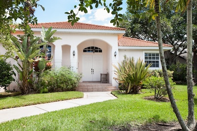 Our home is set in stunning tropical grounds, with orange and palm trees