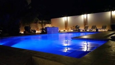beautiful pool, waterfall & pool bar, jetted jacuzz bench, pool table and more