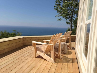 Spacious wrap-around deck with great views of ocean, beach, and island.