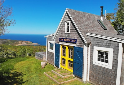 classic oceanside cottage with stunning views over ocean, beach and island.