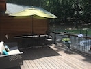 New, larger cedar deck with huge outdoor dining table and umbrella