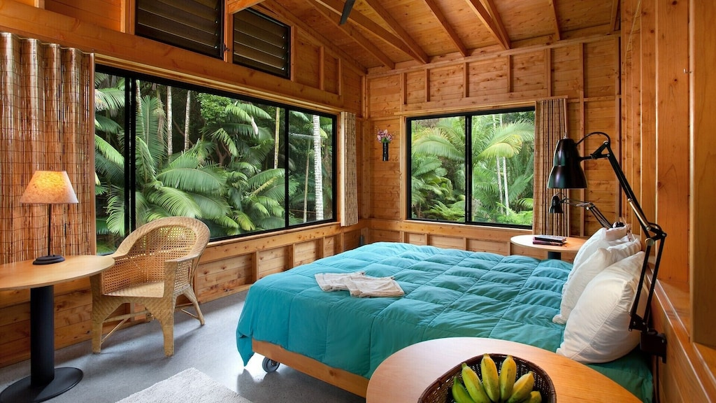 Wooden bedroom interior of a gorgeous home rental in Hawaii