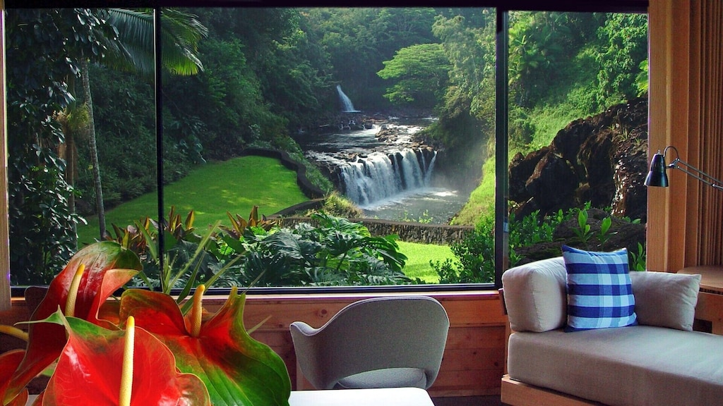 VRBO Hawaii Big Island presents this stylish Hawaii house with red flower arrangement overlooking a waterfall